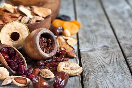 shvat: Mix of dried fruits and almonds - symbols of judaic holiday Tu Bishvat. Copyspace background. Stock Photo