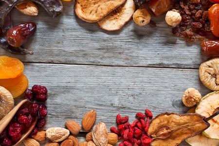 Mix of dried fruits and almonds - symbols of judaic holiday Tu Bishvat. Copyspace background. Standard-Bild