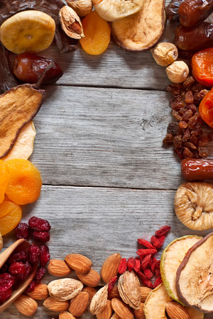 Mix of dried fruits and almonds - symbols of judaic holiday Tu Bishvat. Copyspace background. Stock Photo