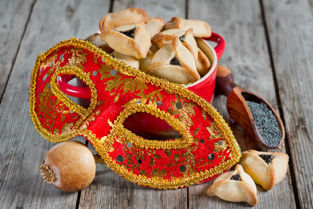 megillah: Hamantaschen cookies or Hamans ears and carnival masks for Purim celebration (jewish holiday).