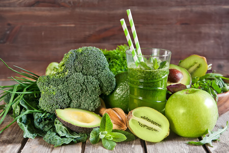 Green detox smoothie with raw vegetables and fruits