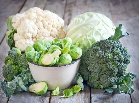 Assortment of cabbages on old wood background Standard-Bild