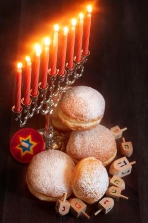 jewish festival: Symbols of jewish holiday hanukkah - menorah, donuts sufganiyot and dreidels