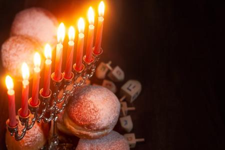 chanukiah: Symbols of jewish holiday hanukkah - menorah, donuts sufganiyot and dreidels