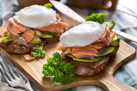 Eggs benedict, scandinavian style - with avocado and poached salmon.