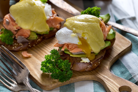 Eggs benedict, scandinavian style - with avocado and poached salmon