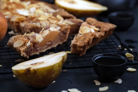 Frangipane tart with poached pears and almond petals. Low key.