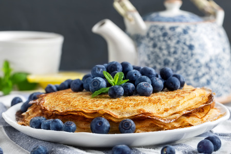 Healthy vegan pancakes crepe with blueberry.