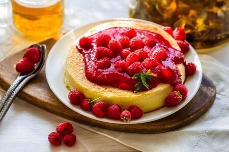 Japan cotton cheescake with raspberry sauce and green tea