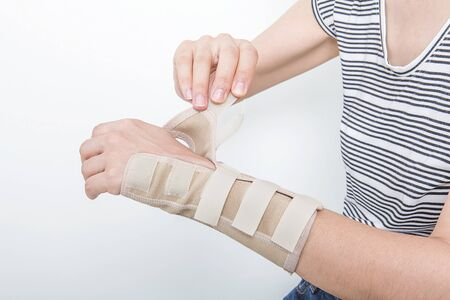 Woman holding her wrist. Pain concept. Woman holding hand to spot of wrist pain. Office Syndrome.Wrist pain.