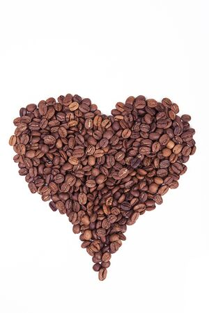 Roasted coffee bean on white background. Heart shape with coffee beans. Stock Photo