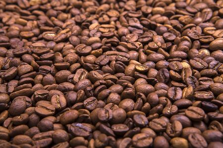 Full frame of roasted coffee beans backdrop. 스톡 콘텐츠