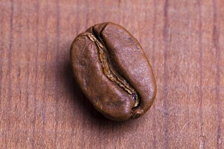 Roasted coffee bean on wooden background. 스톡 콘텐츠