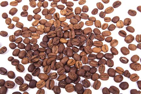 Roasted coffee beans on white background. 스톡 콘텐츠