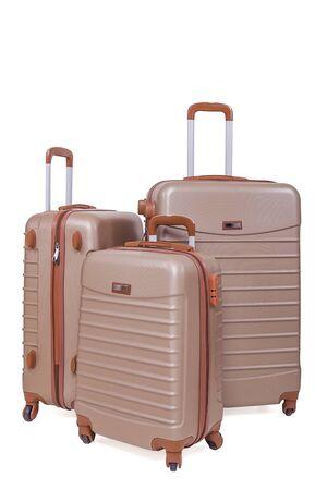 Set of plastic suitcases on wheels on white background.