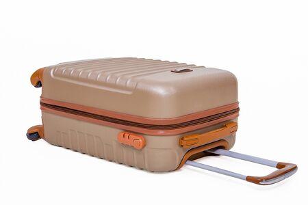 Plastic suitcase with wheels on white background. 版權商用圖片