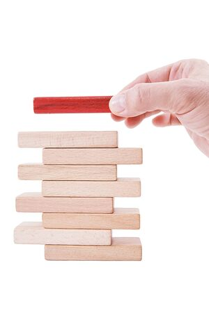 Man chooses one of many wooden blocks. Business concept. Choose the ideal person from many candidates.