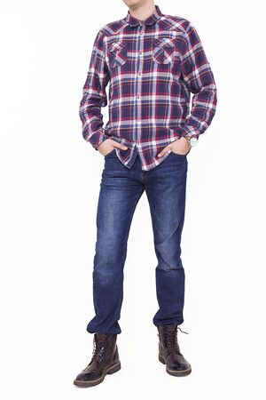 Handsome and confident young man wearing shirt while standing on white background.