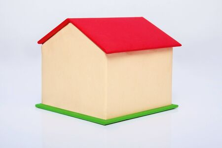 Real estate agent house model. The small house model is made of cardboard. Real estate concept.