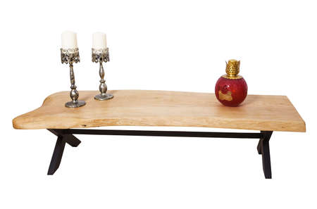 Antique wooden coffee table over white background.