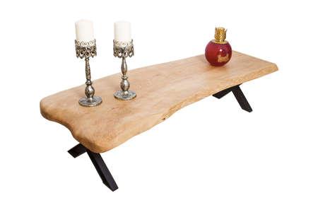 Antique wooden coffee table over white background. Foto de archivo