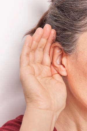 The woman is trying to hear. Hearing problem. Standard-Bild
