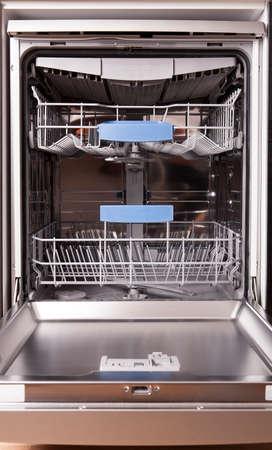 Dishwasher. Washing dishes in the kitchen.