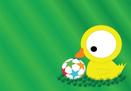 The yellow duck playing football on the grass