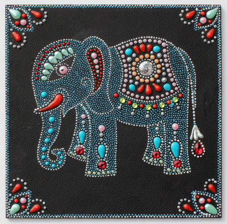 authentic original handmade craftwork painting elephant in ukrainian traditional style with jewelry stones on black background photo