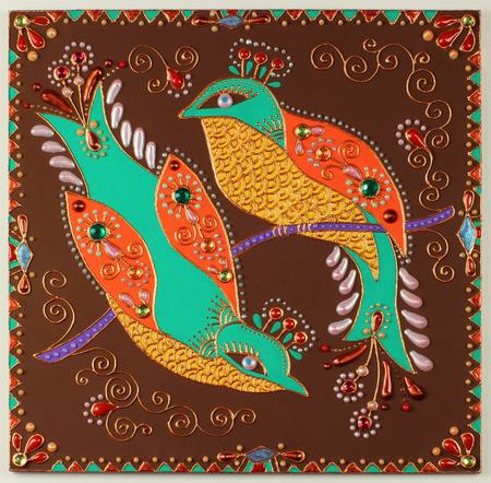 craftwork: authentic original handmade craftwork painting of birds in ukrainian traditional karakoko style with jewelry stones Stock Photo
