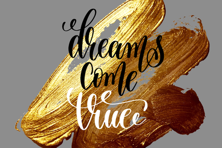 dreams come true - hand lettering positive quote on golden brush