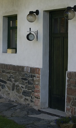 entranceway: Entrance wooden door with two lamps and a replica railway clock