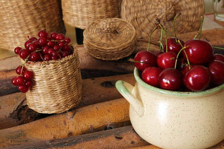 wattled: Sweet cherry in ceramic bowl and red currant in wattled bast basket