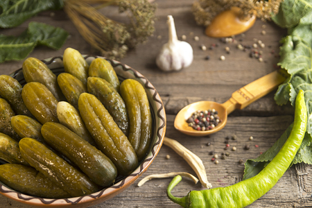 Canned pickled marinated cucumbers with spices and herbs