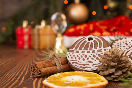 newyear: Christmas gingerbread cookies against background  branch of fir tree and sparks of Christmas garland