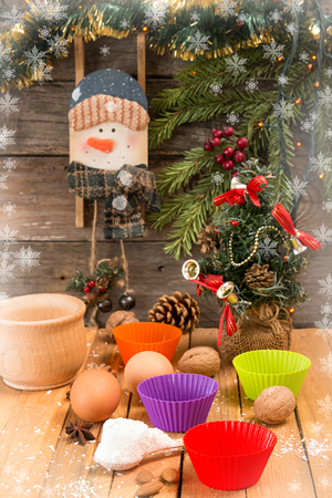 sweeties: Preparation Christmas New Year sweeties. Ingredients and holiday decorations over on wooden table against old wooden background with fir tree branch, small Christmas tree and snowman. Image for greeting card.