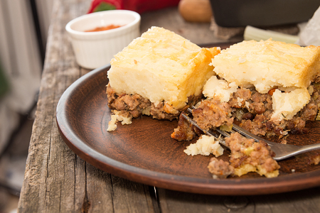 shephard: Shepherds pie traditional english dish. Pie on plate. Recipe with minced beef, lamb, carrot, onion, celery, mashed potato baked in casserole. Rustic style Stock Photo