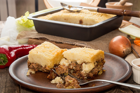 Shepherds pie traditional english dish. Pie on plate. Recipe with minced beef, lamb, carrot, onion, celery, mashed potato baked in casserol. Rustic style. Stock Photo
