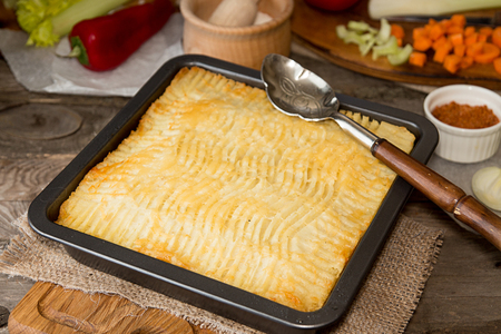 shephard: Shepherds pie traditional english dish. Pie on plate. Recipe with minced beef, lamb, carrot, onion, celery, mashed potato baked in casserole. Rustic style.