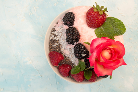 Chia pudding with berries. Dessert with chia, raspberry, blueberry, strawberry and whipped cream. Healthy super food detox concept. Copy space Stock Photo