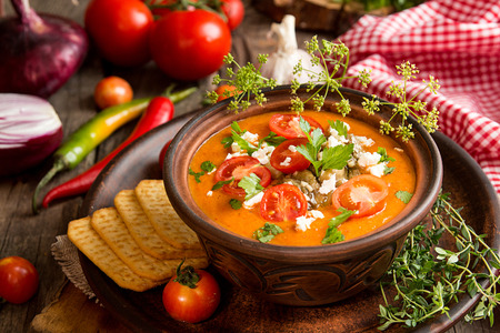 Cream puree soup from baked tomatoes, eggplants, pepper, red onion. Healthy vegetarian food. Rustic style