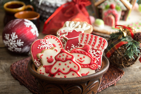 Gingerbread cookies in brown bowl. Christmas New Year holiday decoration.