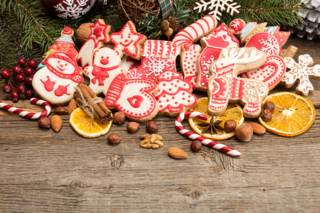 Gingerbread cookies over old wooden background. Christmas New Year holiday decoration. Copy space.
