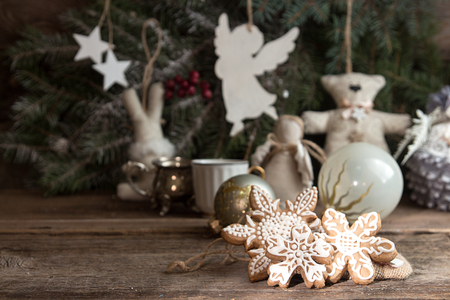 Gingerbread cookies over old wooden background. Christmas New Year holiday decoration.