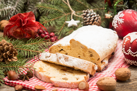 Traditional Christmas dresden cake stollen with candied fruits and almonds. Christmas New Year decoration. Foto de archivo