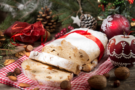 Traditional Christmas dresden cake stollen with candied fruits and almonds. Christmas New Year decoration. 写真素材