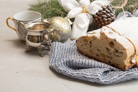 Traditional Christmas dresden cake stollen. Christmas New Year decoration.