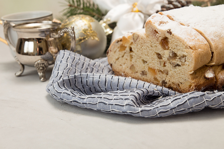 Traditional Christmas drezden cake stollen. Christmas New Year decoration.