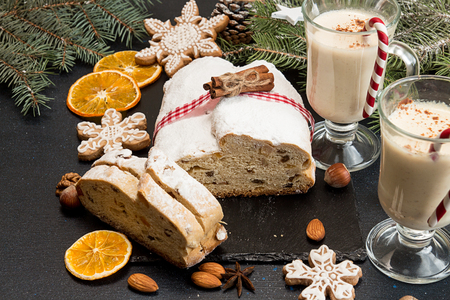 Traditional Christmas dresden cake stollen with candied fruits and almonds. Christmas New Year decoration.Top view.