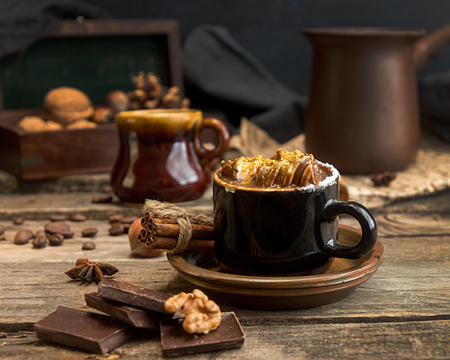 Cup of hot chocolate. Mug of traditional winter chocolate drink. Rustic vintage style.
